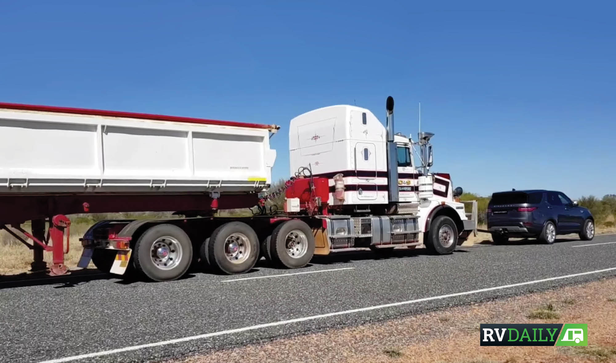 LANDROVER DISCOVERY TOWS A ROAD TRAIN