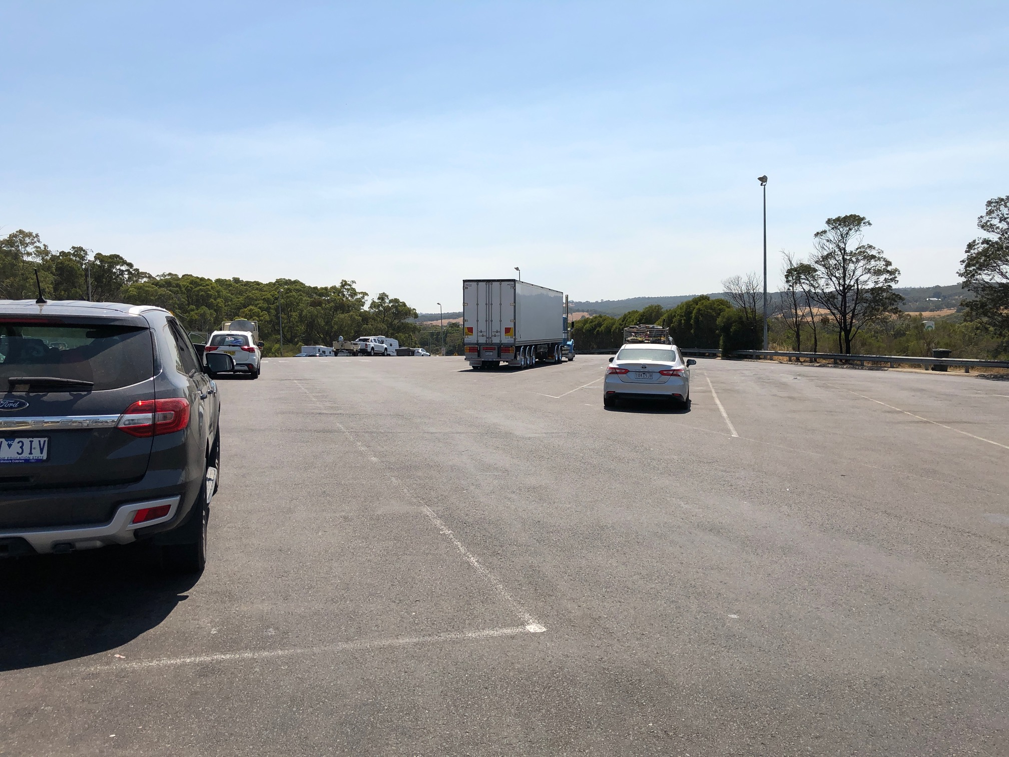 A Day At Bp Northbound In Wallan, Victoria With Cars Parked In The Truck Bays