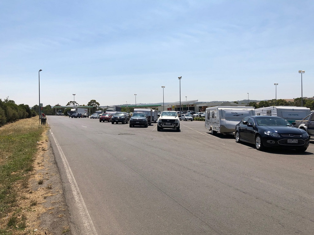 A Day At Bp Southbound In Wallan, Victoria With Cars, Caravans And Boat Trailers In The Truck Parking Bays