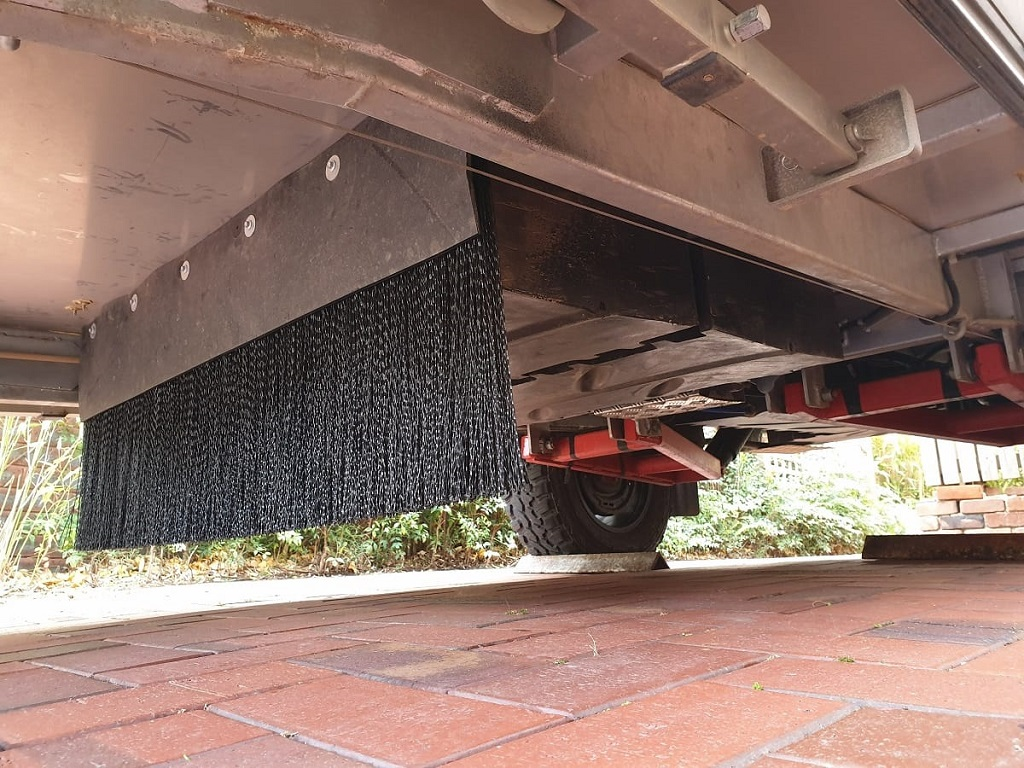 How to keep track debris off your trailer, underbody brush guards