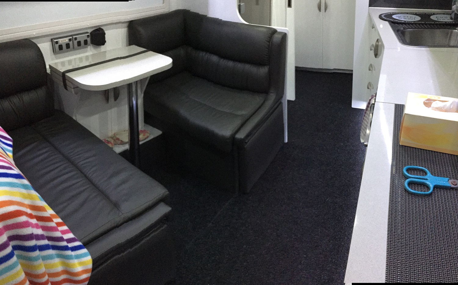 Don't like a cold van floor? This DIY carpet job is for you!