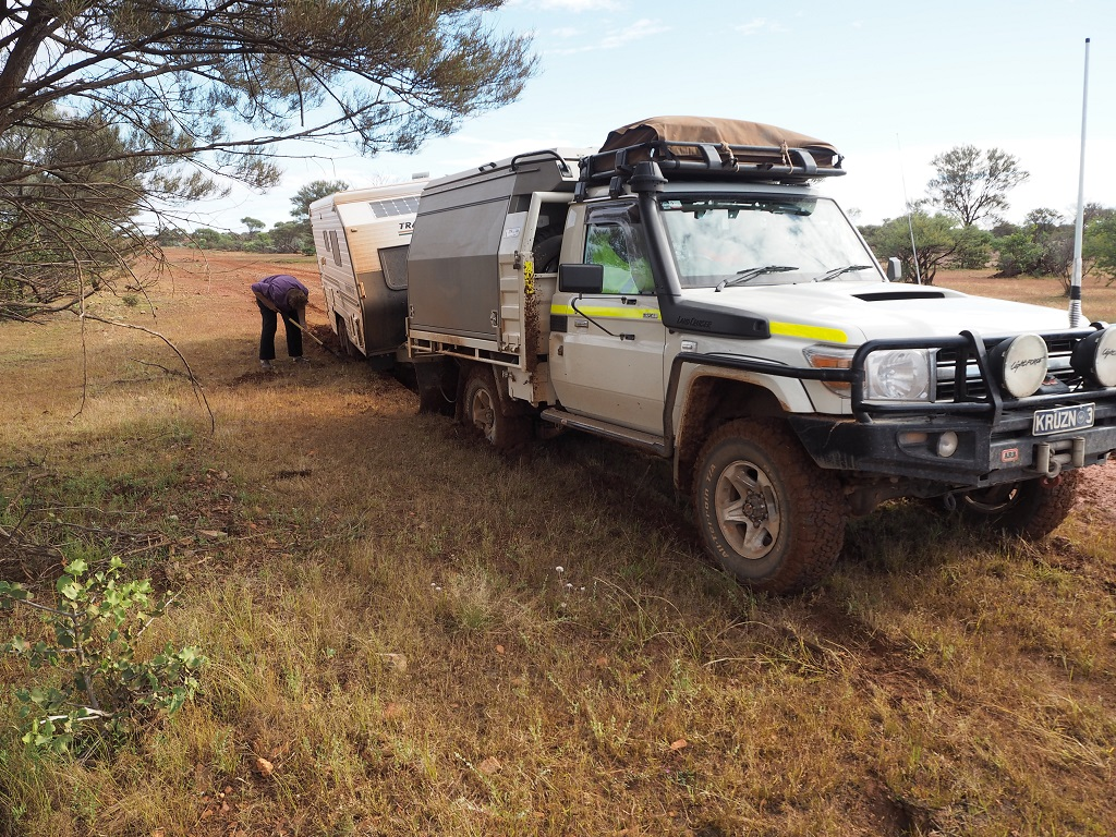 A bogged caravan in red soil