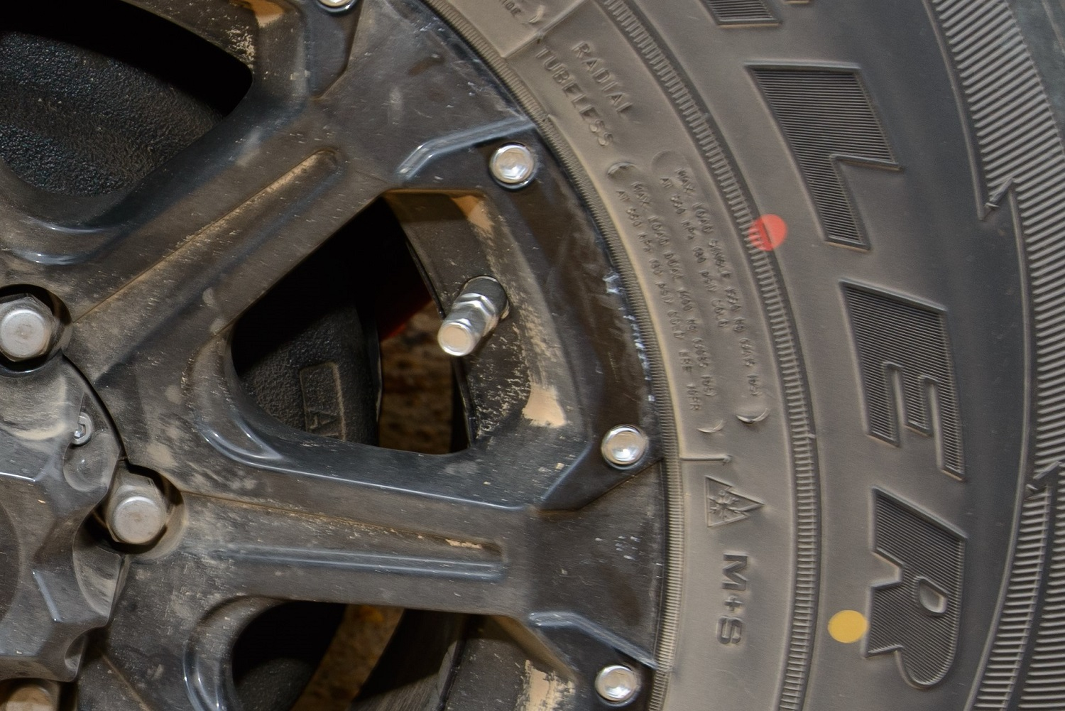 Red And Yellow Dots On A Goodyear Wrangler Tyre